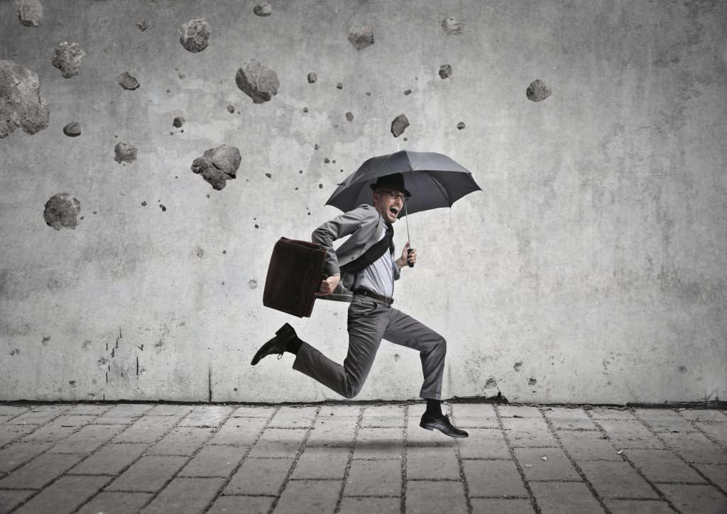 Manager running from a rain of stones